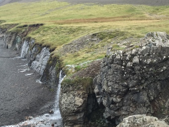 cliffside-waterfall-at-black-beach-off-route-1-enroute-from-hofn-to-egilstaddir